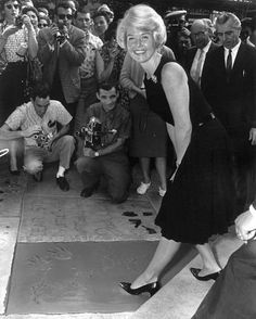 Doris Day At her footprint ceremony at Grauman's Chinese Theater in Hollywood, California. January 19,1961