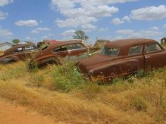 Well, one of these 'abandoned cars and trucks, appears to be a Studebaker.