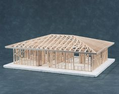 """Hip Roof House Framing Kit - Cat# 83-541001C - $169.00   This 3/4"""" scale kit for a two bedroom home with a Hip roof teaches sound wood frame construction in accordance with accepted building codes. The kit comes complete with Balsa wood, cutting tools, measuring tape, layout pencil, nails, custom miter fixture, instruction booklet, nine working drawings and a work base that doubles as a foundation for the completed model. Includes a bathroom, hallway, dining and living rooms. Grades 6-12."""