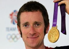 Great Britain's Bradley Wiggins with his gold medal during a photocall at GB house in London after he won it in the Men's Road Cycling Individual Time Trial