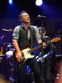"Bruce Springsteen and The E Street band open the ""12-12-12"" concert to aid the victims of Superstorm Sandy at Madison Square Garden."