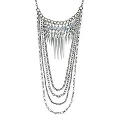 Distinctive silver spiked chain layered necklace with layers of various chain links and a touch of sparkle with rhinestones.