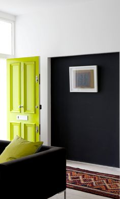 If when it comes to interiors you would rather stick with monochrome shades, why not try adding a bold splash of colour to your front door, so you're dipping your toes in colour without committing. Image: Livingetc