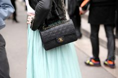 With a Chanel bag.