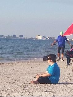 PsBattle: A young boy sitting at the beach with a VR headset on (Xpost- r/cyberpunk)