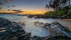 sunset on the tropical island of Maui, Hawaii from secret cove.