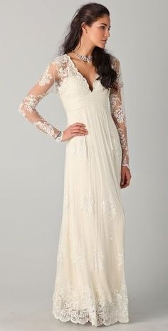 I'm all about sleeves on wedding dresses right now.  Love the top