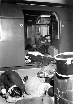 People sheltering in a tube train and on the platform at Piccadilly Tube Station, London, during an air raid. 1940 (Photo by Tunbridge-Sedgwick Pictorial Press/Getty Images).