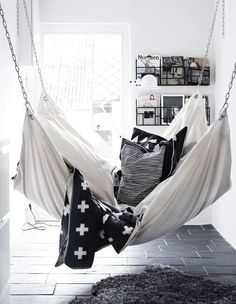 A hammock is the perfect place to recline and relax. Install an indoor hammock for beachy relaxation all year long. For more indoor hammock design ideas, visit domino. My New Room, My Room, Dorm Room, Spare Room, My Ideal Home, Bedroom Sofa, Bedroom Hammock, White Bedroom, Living Room Hammock