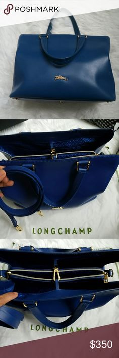 Longchamp Honore 404 Medium Kerrington Blue Shoulder bag in calfskin.  You can put a tablet in the middle compartment which has a zipper.  In good to excellent condition. Longchamp Bags Shoulder Bags