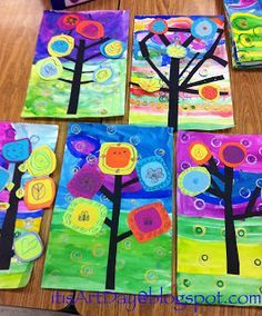 Oooh- this is a great Kadinsky project. Paint background and stamp circles.  Second day- cut trees and two colors for circle leaves.