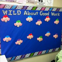 Bulletin board with clothes pin monkeys. It makes it easy to hang up and change student work.