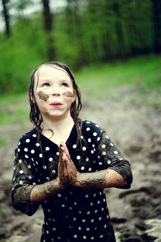 I love the fact that she's all girly- yet playing in the mud