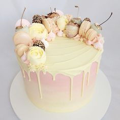 "Life is a little rosier with a ""pretty in pink"" layer cake in it #prettycake #pinkcake #macarons #meringues #gildedfruit #dripcake #ombre #bakeninja #instacakers #bakeandshare #cakeporm #wiltoncakes #instacakes #buzzfeedfood #igcakes #cakeoftheday #cakegram #cakestagram #teamchomp #vscofood #cakelover #thebakefeed #huffposttaste #yahoofood #undiscoveredbaker #mycupcakeaddiction #marthabakes #ohitsperfect"