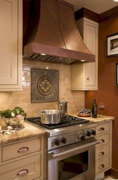 Ceramic subway tile with granite countertops and a copper hood.