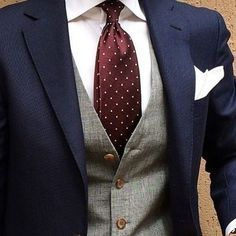The grey waistcoat is a great compliment to the navy suit and maroon tie. Don't be afraid to experiment.