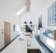 Architect Mhairi Grant of Paper Igloo converted this Scottish farmhouse into a contemporary residence that features an expansive kitchen with a vaulted ceiling. by interiordesignmag Small Kitchen Diner, Small Open Plan Kitchens, Open Plan Kitchen Living Room, Long Kitchen, Kitchen Ideas, Minimalist Dining Room, Minimalist Home Interior, Interior Design Magazine, Living Room And Kitchen Design