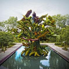 """Huge Sculptures Made of Flowers - Uphaa.com.  An international Mosaiculture competition in Montreal, Canada. Mosaiculture, """"is a refined horticultural art that involves creating and mounting living artworks made primarily from plants with colorful foliage (generally annuals, and occasionally perennials)."""" #garden #ecoart #sculpture #flowers"""