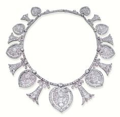 AN ANTIQUE DIAMOND NECKLACE/TIARA--designed as nine graduated old-cut diamond stylised heart motifs with diamond floral spacers, seven heart motifs detachable to form clip brooches, with fittings and tiara frame, circa 1900