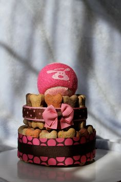 Pretty in Pink dog biscuit cake by HappyTiersbyAllison on Etsy  What a great gift idea for a new puppy!!!!