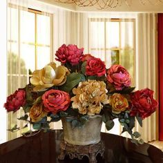 "Elegant Centerpiece with Hydrangea, Magnolia, Roses AR336 - This breath taking arrangement will add class to your décor and you will be the envy of your guests. Created with High quality silk flowers, crafted with hydrangeas, roses, and peonies 24""L x 20""H"