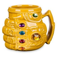Genuine, Original, Authentic Disney Store Hot beverage mug Sculpted Thanos Infinity Gauntlet design Faceted jewel Infinity Stone accents Inspired by Marvel's Avengers: Infinity War Infinity Gems, Disney Infinity, Deco Disney, Disney Pixar, Thanos Avengers, Thanos Infinity Gauntlet, Disney Mugs, Disney Souvenirs, Cool Mugs