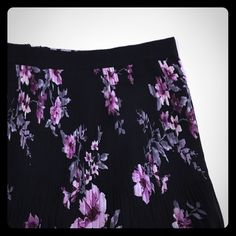 """Forever 21 Floral Print Skirt Forever 21 floral print skirt. Like new condition - only worn once. Purple and gray floral print. Pleated skirt with black semi attached lining. Black ribbon waistband. Back zipper closure.  Measurements: Waist 28.5"""" Length 17"""" Forever 21 Skirts A-Line or Full"""