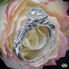 Verragio 4 Prong Cushion Halo Diamond Engagement Ring is set in 18k white gold and holds a 0.712ct A CUT ABOVE® Diamond.