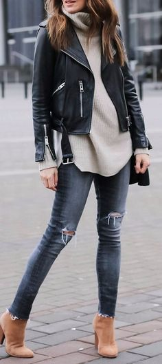 camel booties pairing with rips and a leather jacket