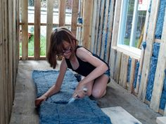 9-year-old girl builds tiny homes from scratch for the homeless windows, a lockable front door, recycled denim insulation, vinyl flooring, drywall, shingled roof, and a solar-powered lamp!