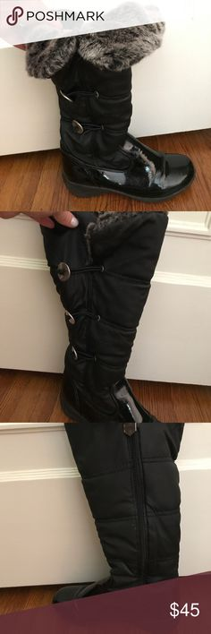 Khombu black patent leather snow boot size 8 Only seen 2 snow seasons (only 1 snow a season...). Great condition. Can be worn all black. Or can show the faux fur by rolling down the top of the boot. See photos of me -- girl on the right! So comfortable. Khombu Shoes Winter & Rain Boots