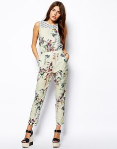 Jumpsuit by ASOS Collection Made from a woven poly-blend. Crew neckline. Mixed print design. Fitted waist. Side pockets. Zip back fastening. Regular fit.