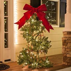 DIY Christmas Lights - Create a Christmas tree topiary using a tomato cage, garland and white Christmas lights!, plus other great tomato cage tree ideas! Christmas Tree Topiary, Diy Christmas Garland, Diy Christmas Tree, Christmas Tree Decorations, Christmas Ideas, Tomatoe Cage Christmas Tree, Yard Decorations, Christmas Planters, Christmas Mantles