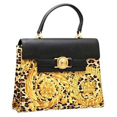View this item and discover similar handbags and purses for sale at - Gianni  Versace baroque print bag. 93bfbe3a5ecd4
