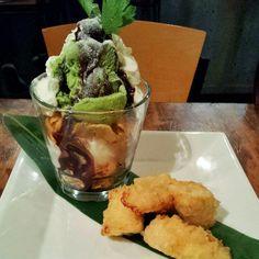 Parfait with green tea ice cream, vanilla ice cream, cornflakes and special request deep fried banana... random cilantro garnish bothers me more than it should. @guuizakaya #Kobachi