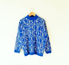 Crazy awesome vintage sweater in a bold cobalt blue, with silver alphabet lettering.