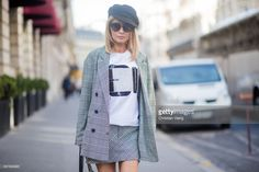 Gitta Banko wearing checked blazer and skirt from Zara, t-shirt by Marina Hoermanseder, white bow-embellished lace leather sandals by Stella Luna, black leather Boy bag by Chanel, black Baker Boy hat by Gianfranco Ferre and Chanel sunglasses seen during Paris Fashion Week Spring/Summer 2018 on October 3, 2017 in Paris, France. Thema Paris, Marina Hoermanseder, Baker Boy, Chanel Sunglasses, Checked Blazer, Spring Summer 2018, Rain Jacket, Windbreaker, Raincoat