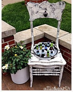 This unique cooler was made from an antique chair. The metal pot in the center comes with a lid and also lifts out to empty melted ice. The pot can easily hold 24 bottles. There is a bottle opener on