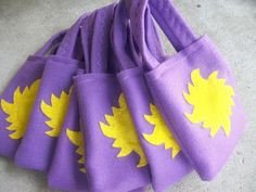 Rapunzel Party bags via Etsy. Could also use purple paper bags and glue the yellow star
