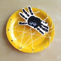 Handprint spider paper plate spiderweb craft for halloween