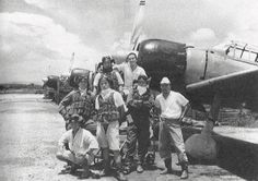 Pilots of Japanese Navy 202nd Air Group, Kupang, Timor, Dutch East Indies, Feb 1943; note Yoshiro Hashiguchi (left most pilot), Kiyoshi Ito (right most pilot), and Zero fighters.