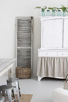 Like the skirt on this cabinet.  Simple way to hide clutter w/o making or restoring doors/drawers.