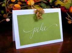 rehearsal dinner place card - name on both sides, so others can see it, too.  Not everyone will have necessarily met yet!