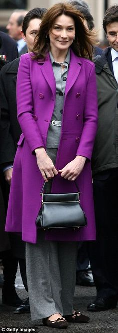 Not really royalty, but... Carla Bruni in Dior purple coat -- She's mastered the royal solution for standing out in a crowd