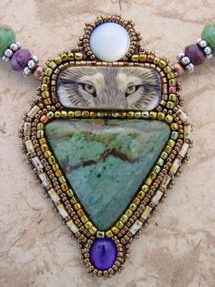 """Wolf Eyes Necklace by Heidi Kummli  porcelain """"Wolf Eyes""""by Laura Mears"""