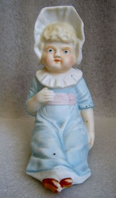 GERMAN BISQUE PIANO BABY w BONNET DRESSED IN SOFT SHADES OF BLUE PINK & WHITE #Unknown