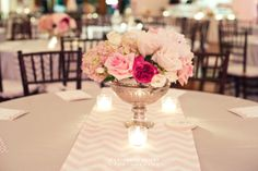 Love this center piece! What about chevron runners in your accent color, on burlap tablecloths or runners? Then flowers in white and just a touch of blush (no bright pinks like they are here)