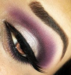 Purple and silver eye makeup with black liquid gel liner and false lashes