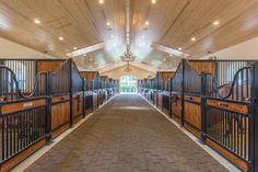 inside a stunning horse barn