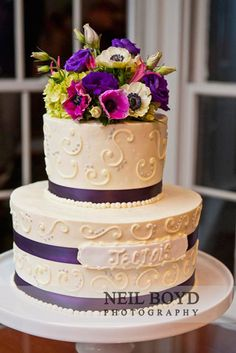 White icing wedding cake with purple flowers in Raleigh, NC.